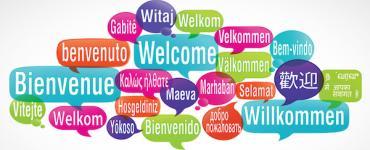 Tekstballonnen met 'welkom' in verschillende talen
